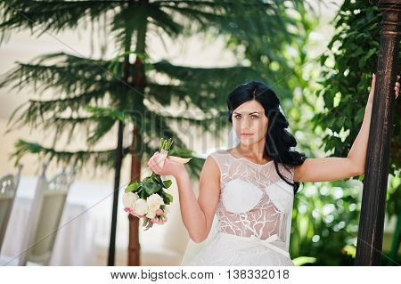 Temptation Model Brunette Bride At Exciting Wedding Dress Posed Near Lantern At Wedding Hall
