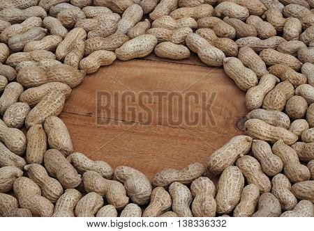 peanuts in a circle on the wooden boards
