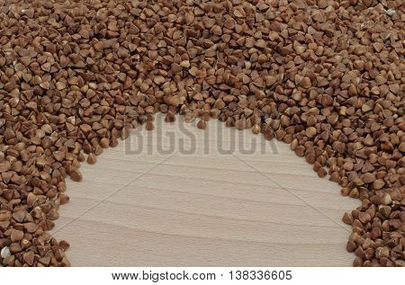 semicircle with buckwheat on a wooden board