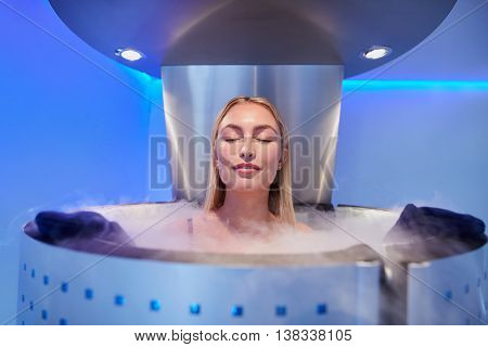 Young Woman In A Whole Body Cryotherapy Cabin