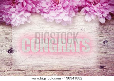 pink flowers on wooden with word Congrats