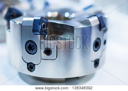 Modern milling cutter with indexable inserts. Shallow depth of field.