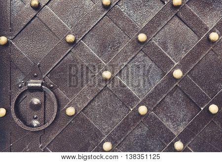 Vintage metallic pattern of medieval gate. Decorative grunge checkered iron structure background. Architectural detail