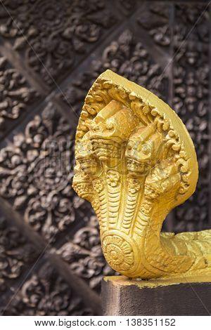 Gold five-headed naga snake sculpture in Cambodia