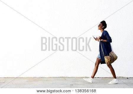 Trendy Black Woman Listening Music On Mobile Phone