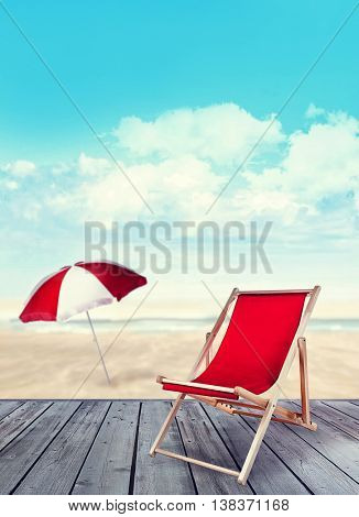 Wood deck with beach chair and ocean in background
