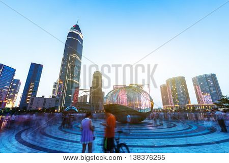 hangzhou,china: modern abstract office buildings in hangzhou West Lake culture plaza at twilight on view from empty street by zhudifeng on June,10,2016
