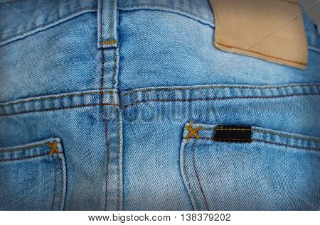 Stock Photo - Blue torn denim jeans background