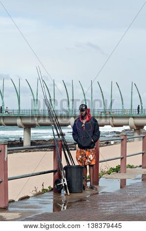 DURBAN SOUTH AFRICA - JULY 09 2016: Fisherman at the beach near the Millennium Pier in Umhlanga Rocks