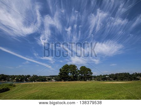 Random Wispy White Cloud Formations in Blue Sky