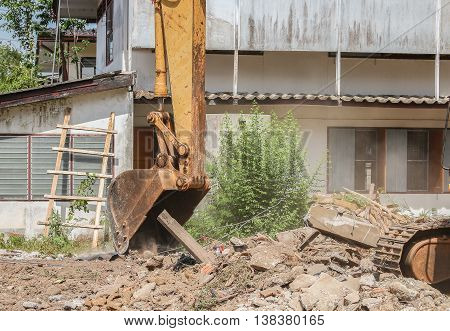 bucket Excavator selective focus, destruction in Work outdoor  construction,and  dust soil motion