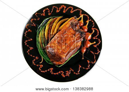 roast red beef meat bbq bloc served on black plate  with green chives and red hot pepper on black plate isolated over white background