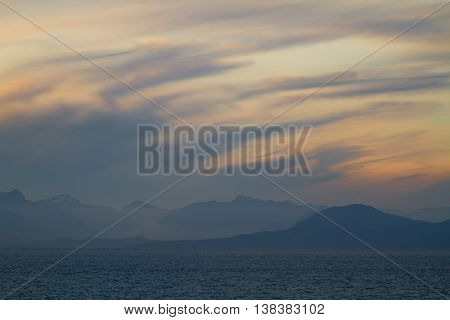 A Beautiful Canadian landscape with mountains, the Pacific Ocean and a cloudy sunset.