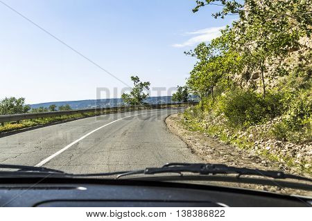 The view from the car on twisty road section