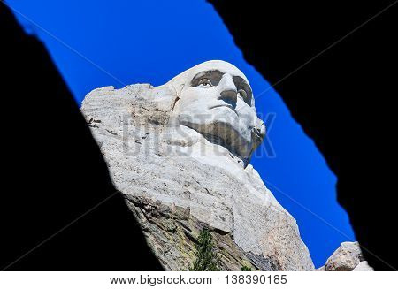 Looking up at Washington through a crack at Mount Rushmore