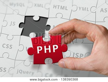 Hand Of Programmer Holds Puzzle With Php Programming Language