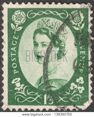 MOSCOW RUSSIA - JANUARY 2016: a post stamp printed in the UNITED KINDOM shows a Portrait of Queen Elizabeth II circa 1956
