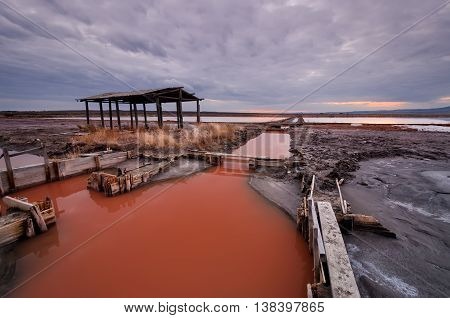 Part of salt lake near Burgas where live miniature crabs Artemia Salina which give the red color of the water.
