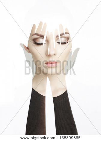 Conceptual art fashion studio photo of beautiful young woman with perfect makeup