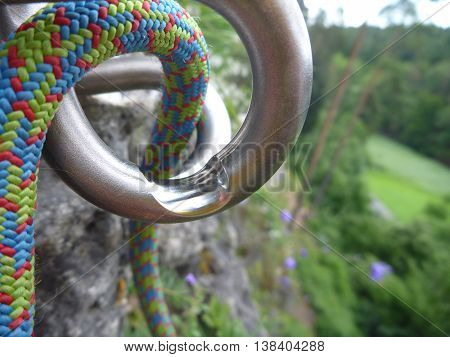 Used Rapelling Top Metal Device On A Sport Climbing Route