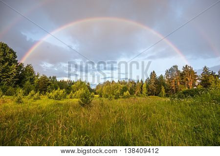 Double rainbow. Beautiful nature landscape. Summer nature after rain.