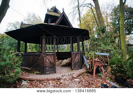 Black Old Wooden Summerhouse At Autumn Yard