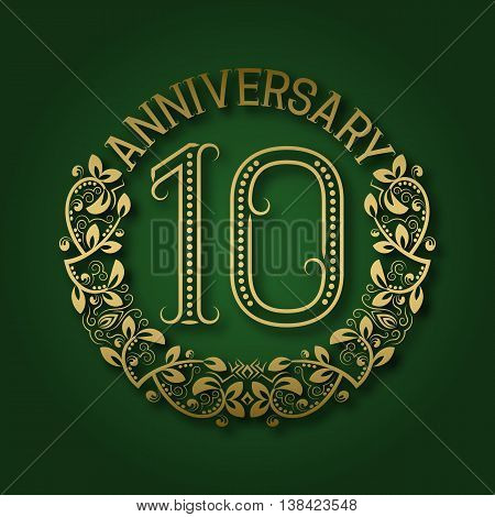 Golden emblem of tenth anniversary. Celebration patterned logotype with shadow on green.