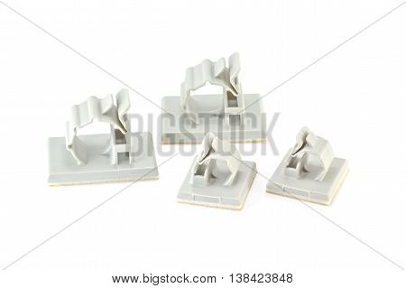 Closed up Round Releasable Cable Clamps on white background