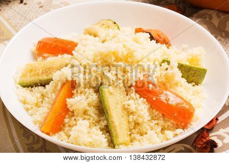 Healthy vegetarian couscous dish with vegetables. Moroccan cuisine