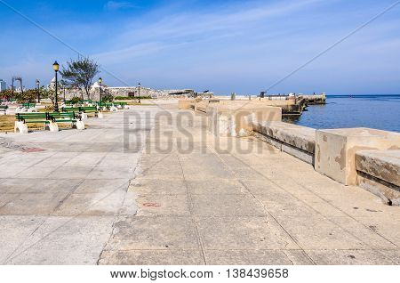 Calm park in the Malecon near Morro Castle in Havana the capital of Cuba