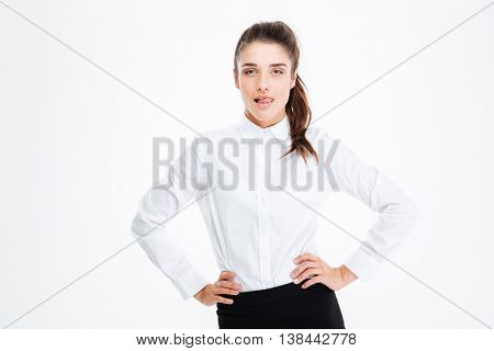 Portrait of confident seductive young busineswoman over white background