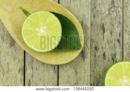 lime slice and leaf on wood padle