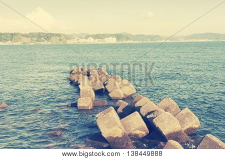old submerged breakwater structure in Kamakura Japan by sunny day