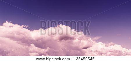 Horizontal vivid purple tinted wide pano bottom aligned cloudscape design element background backdrop
