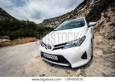SITIA, CRETE, GREECE - AUGUST 1, 2016: Closeup of Toyota Auris staying among mountains near Sitia town on Crete island, Greece