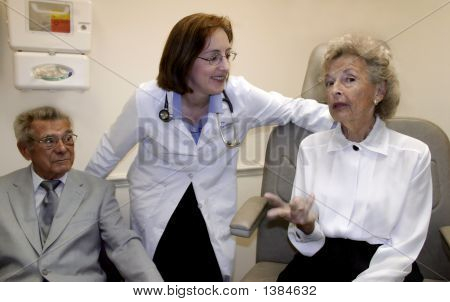 Caring Doctor And Her Patients