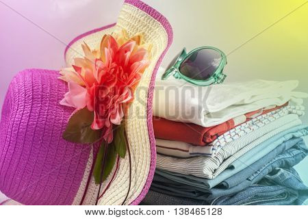 Pile of colorful clothes and Beautiful summer hat sweet beautiful color tone background