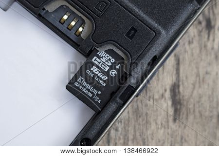 BUNG KAN THAILAND - APRIL 04 2016: micro sd card on top of smart phone soft focused