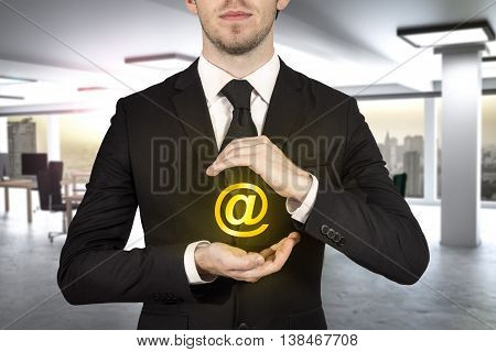 businessman in black suit protecting at sign in modern office