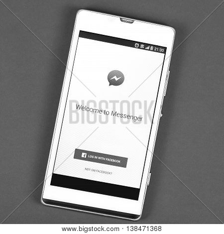 BUNG KAN THAILAND - FEBRUARY 19 2016: smart phone display facebook messenger app black and white