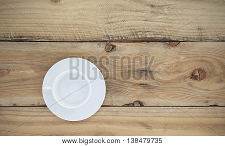 Empty white coffee cup on old woodenTop view.