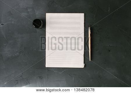 notesheet on the black stone background. above view