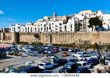 Peniscola Spain - March 3 2016: Car parking and view to the old town of Peniscola. Costa del Azahar province of Castellon Valencian Community. It is a popular tourist destination in Spain