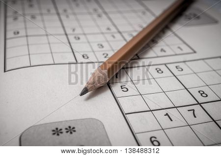 Pencil and sudoku crossword. Popular puzzle game.
