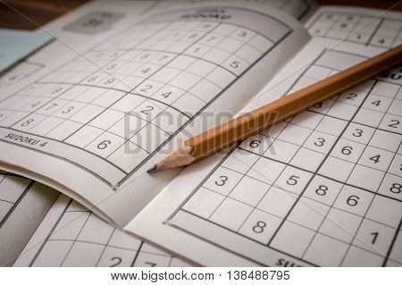 Pencil and sudoku crosswords - popular puzzle with numbers.