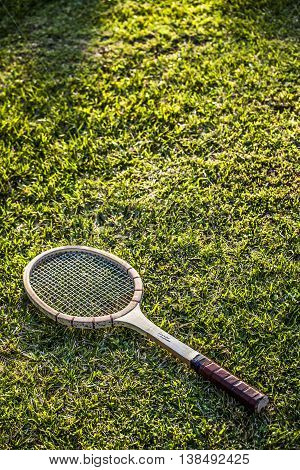 Vintage Wood Tennis Racket On Green Grass Garden