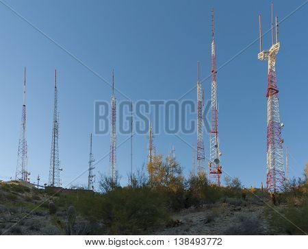 TV and radio transmitter towers on the top of the hill.