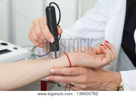 Dermatologist examining birthmarks and moles on a female patient (examination of birthmarks) poster