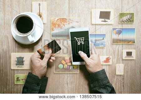 Person hands with credit card and mobile phone at desk Online shopping concept