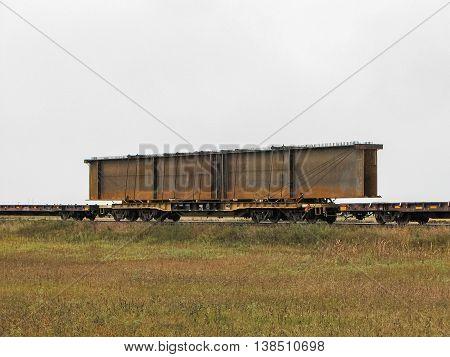 Large Rusty Steel Beam on Railway Flatcar